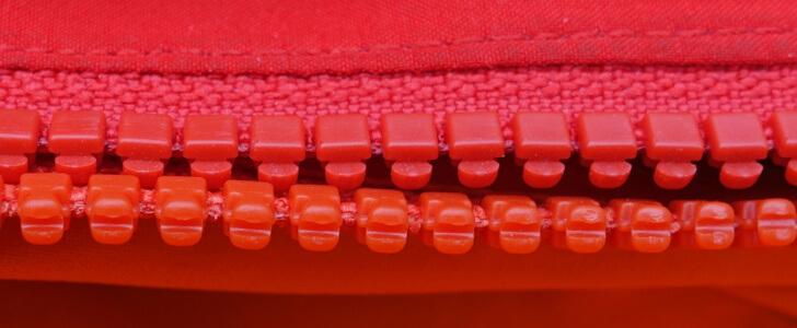 Many of Black Diamond's zippers sacrifice durability for aesthetics. The top zipper (Black Diamond Heat Treat) is half as thick as the standard parka zipper, below (Arcteryx Kappa).