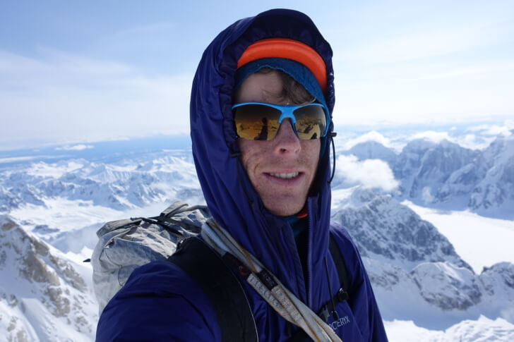 Max Neale in the Arc'teryx Nuclei AR jacket on the summit of Moose's Tooth, Alaska Range.