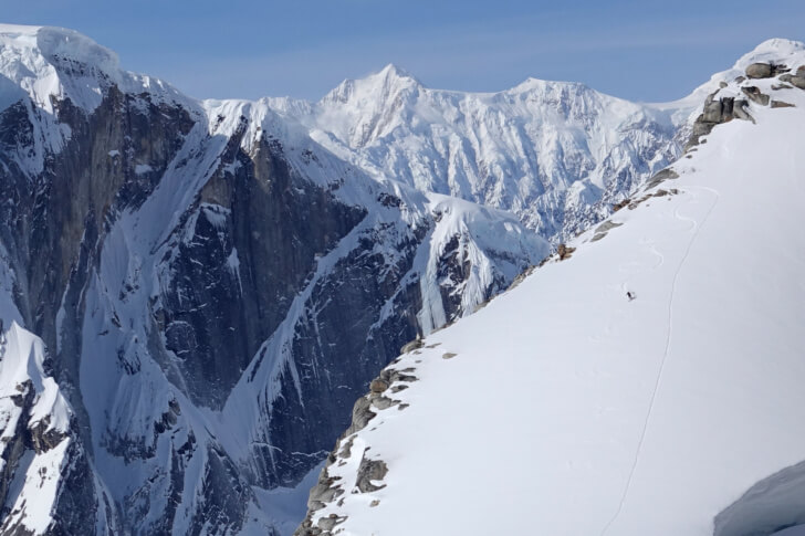 Eric Shaw enjoying afternoon turns in the Patagonia Nano Air Hoody. Moose's Tooth, Alaska Range.