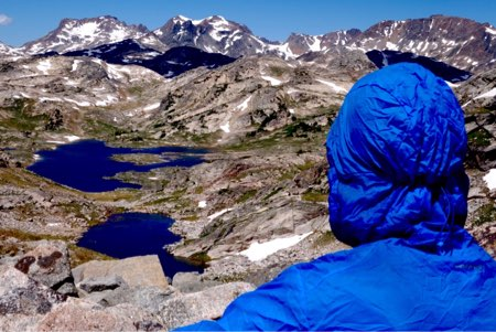 Eric Vann looks at the horizon of Big Beartooth Peaks, with Fossil Lake in the distance.