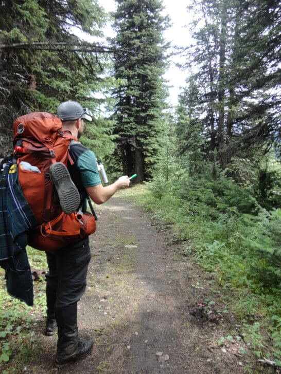 Marvel Pass Backpacking Trail - deploying bear spray and a bear banger.