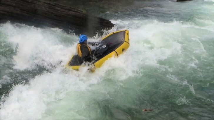 Packraft Reviews: Ben Scholten shoots a rapid in a Kokopelli Nirvana equipped with a whitewater spray skirt.
