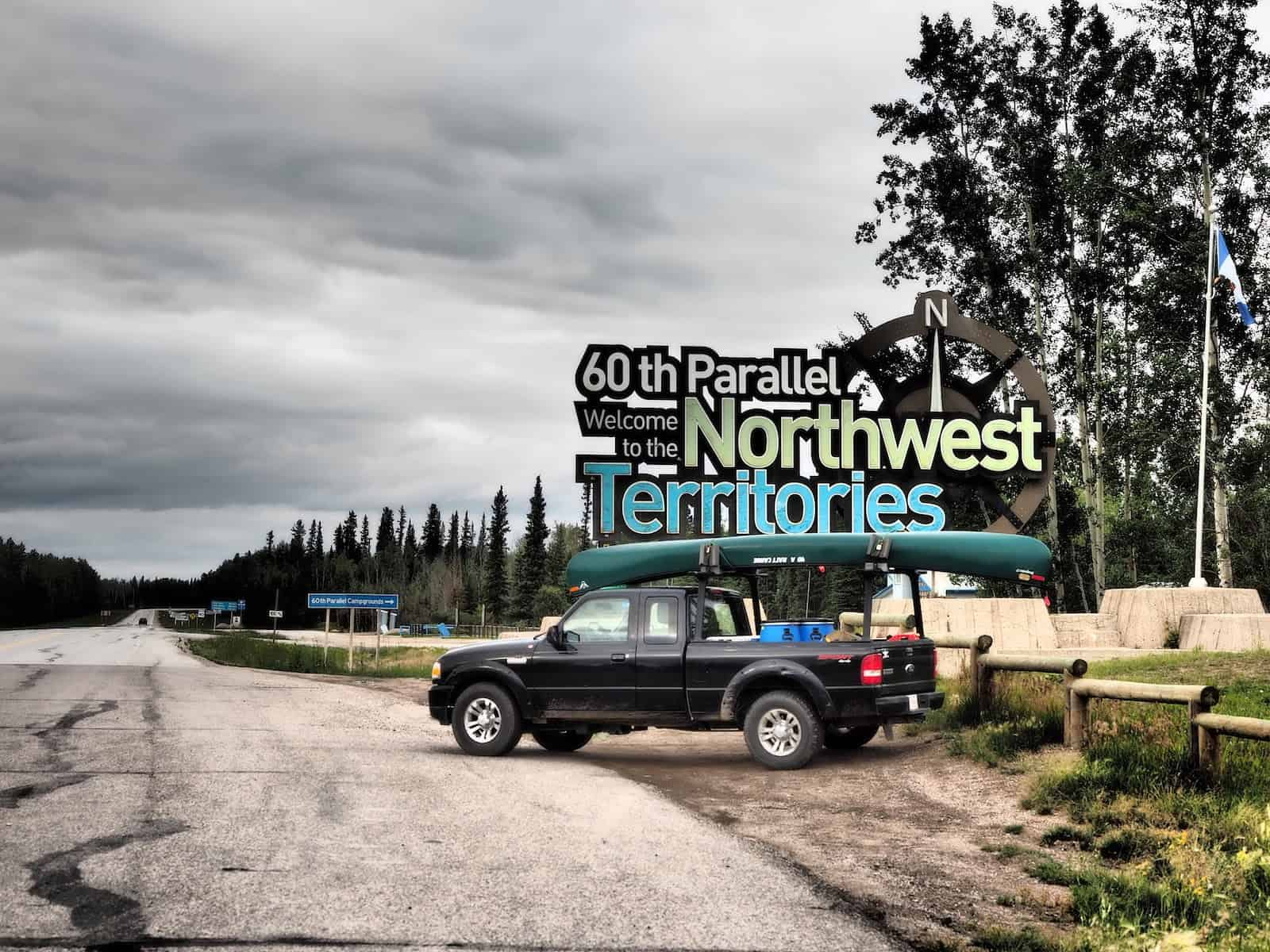 Nahanni River by Canoe: 60th parallel sign