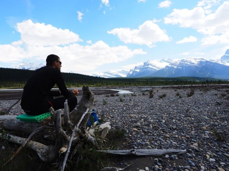 Nahanni River by Canoe: Sitting on top of canoe on a gravelly shore.