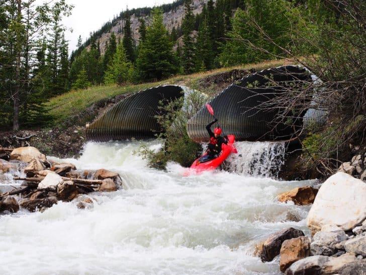 Nahanni RIver by Canoe: Kayaker on whitewater near Jasper, Alberta, Canada.