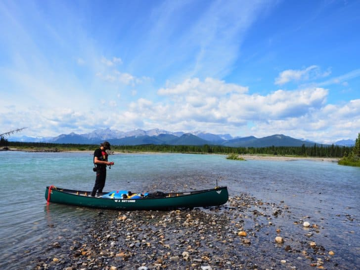 Nahanni River by Canoe: Canoe beached on a gravel bar in a river
