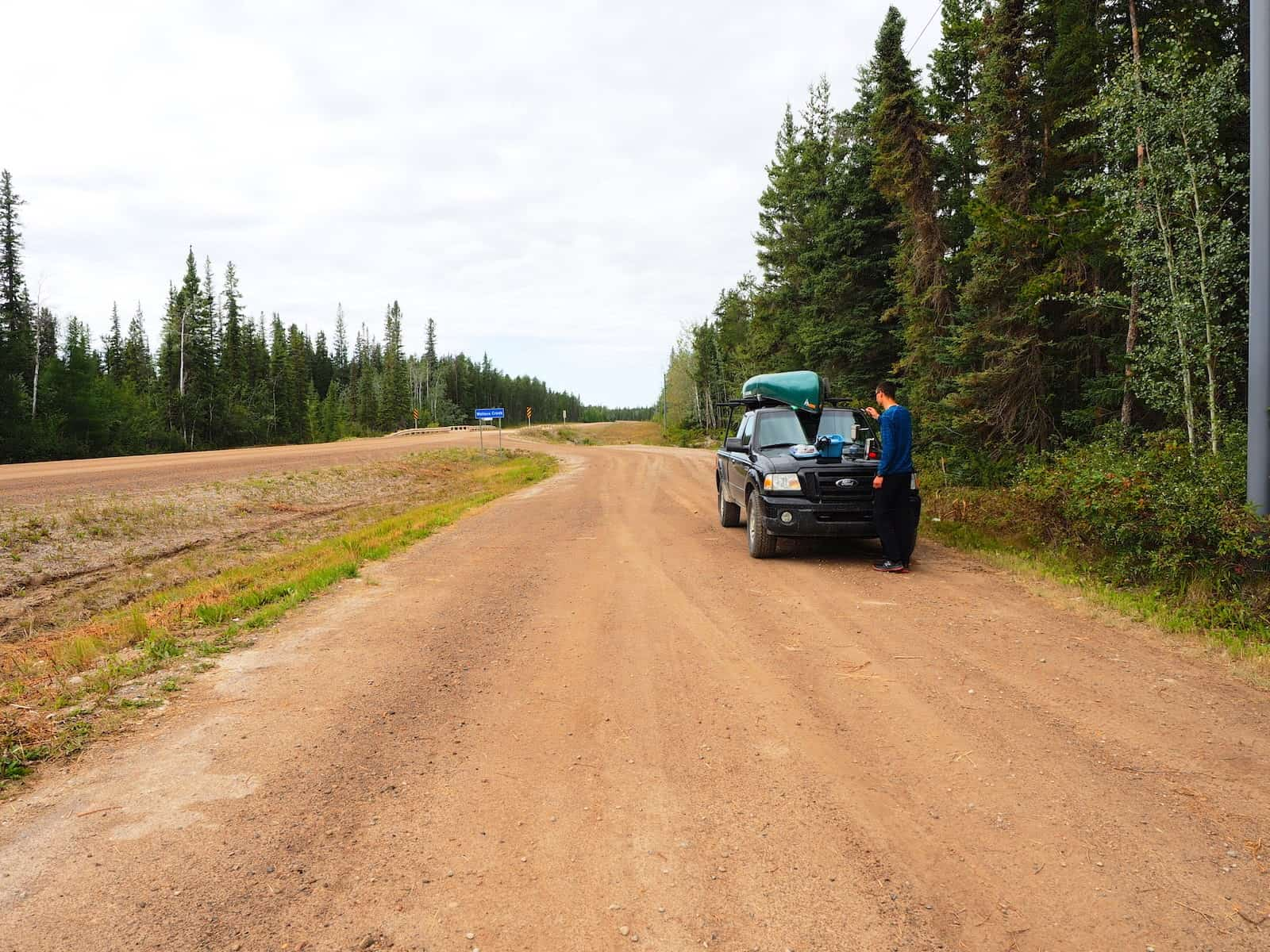 Nahanni River by Canoe: Truck pulled to side of dirt road.