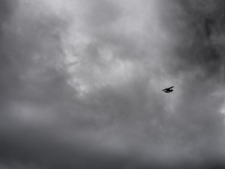 Nahanni River by Canoe: Bush plane silhouetted against clouds.