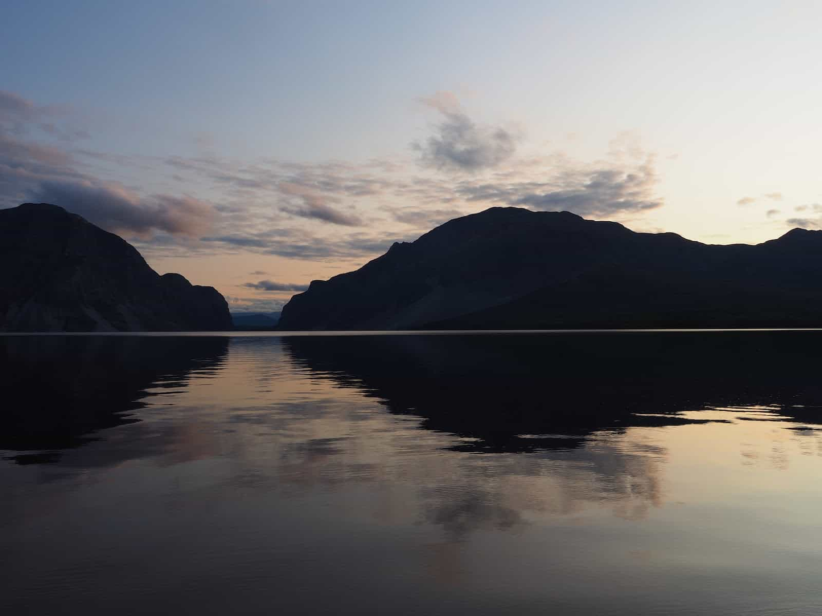 Nahanni River by Canoe: Sunset over a placid lake.