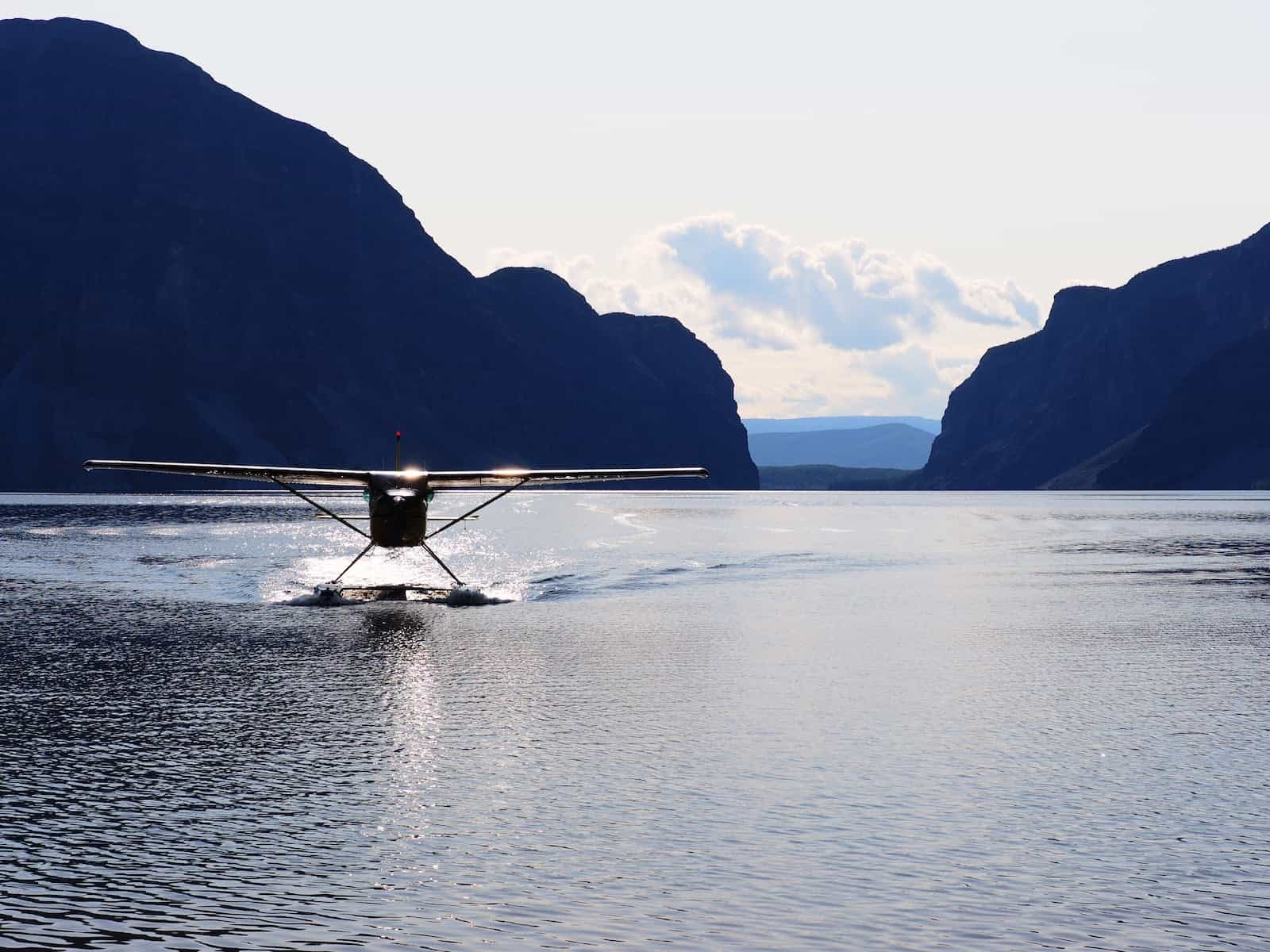 Nahanni River by Canoe: The Cessna coming into Little Doc Lake