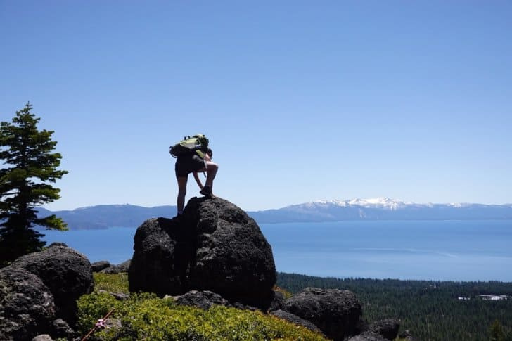 relationship while backpacking: view of a boulder looking over Lake Tahoe