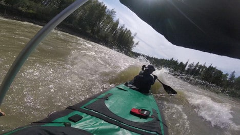 Nahanni River by Canoe: The front of the canoe pushes through rapids