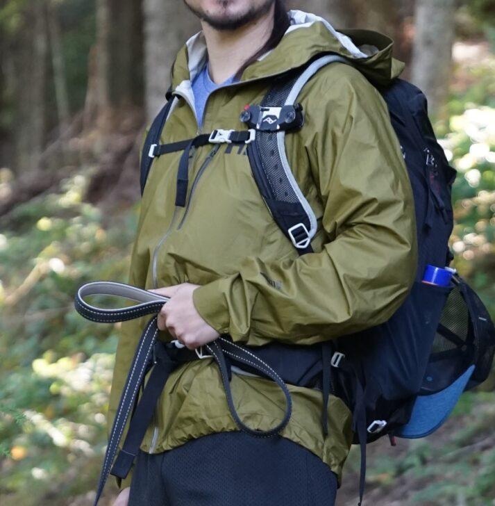 The Helly Hansen Rain Jacket worn under a backpack
