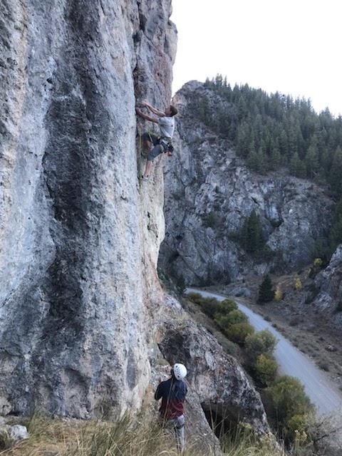 Belaying a climber