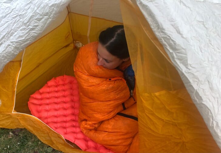A Backpacking Confession: Maggie sits in her tent, wrapped in a 10-degree, 900-fill mummy bag.