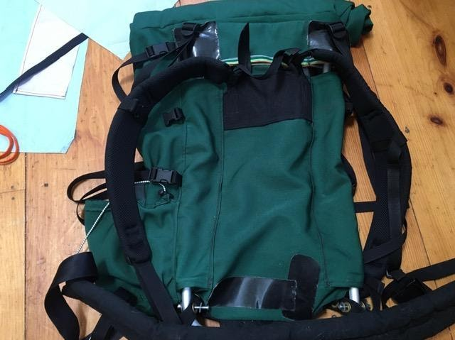 A duct-tape and long used backpack