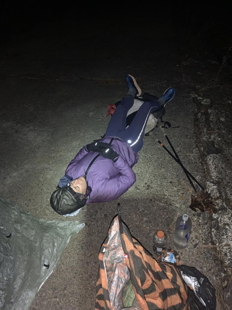 lying down on the trail, at night, resting