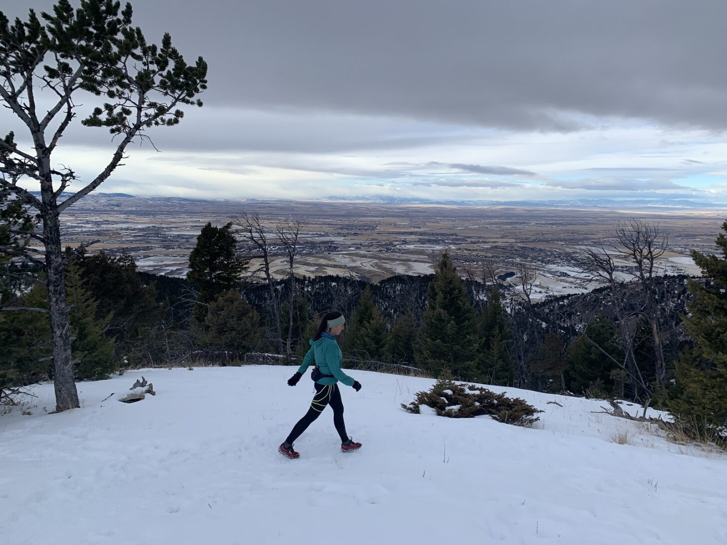 A woman hikes on a hill above the city of Bozeman, Montana