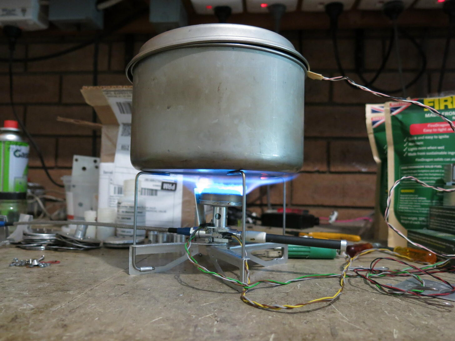 a lit stove and pot in a workshop