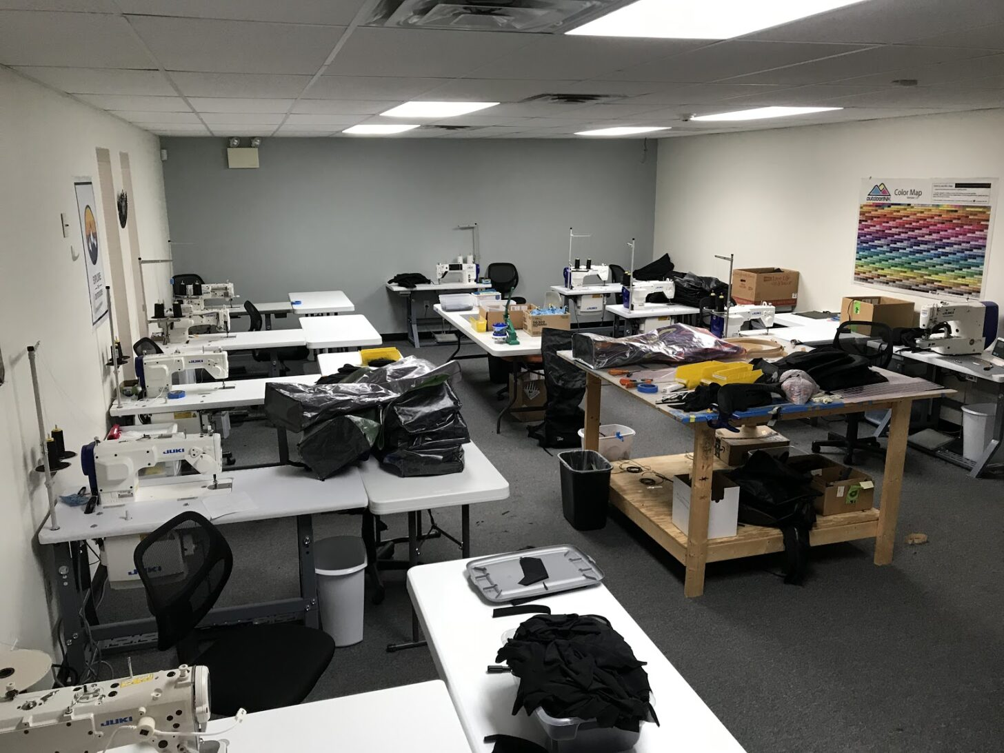 a sewing room with desks and sewing machines