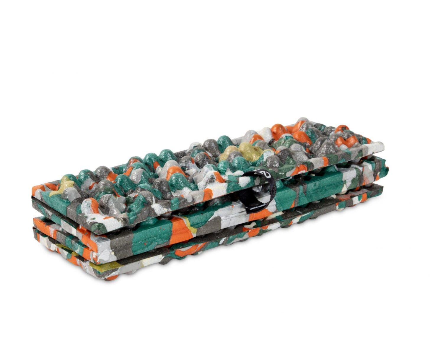 a multicolored, folding sit pad