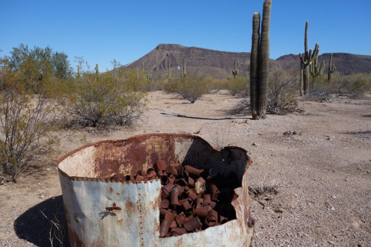 a pile of rusted tin cans