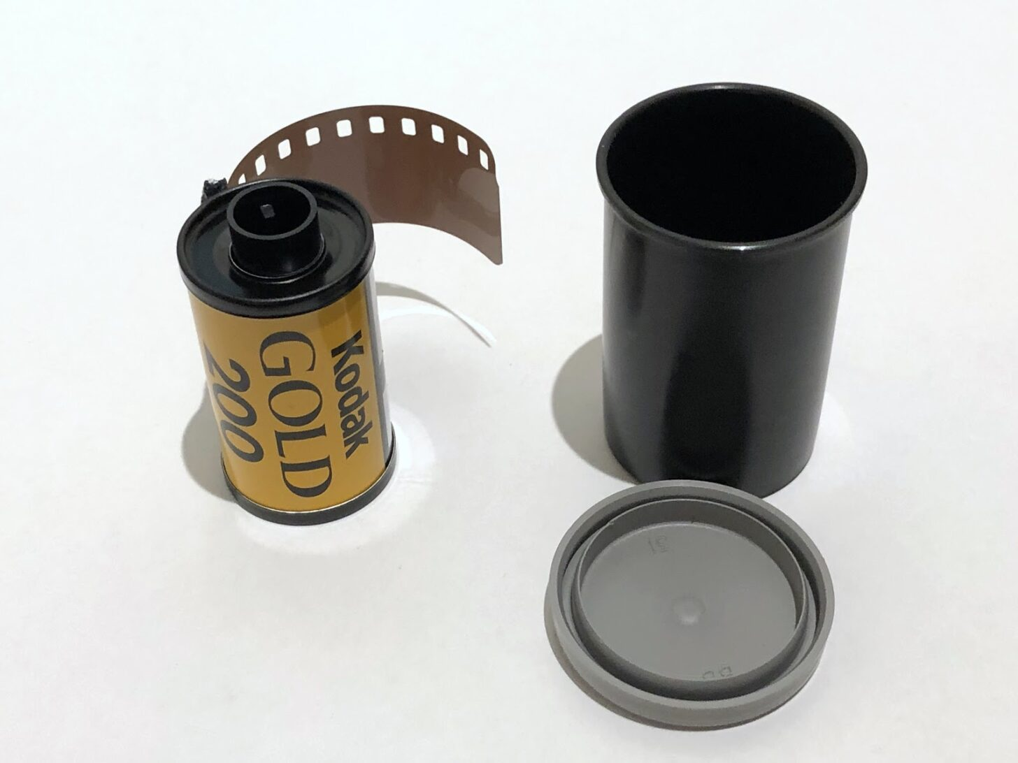 a roll of film and a film canister