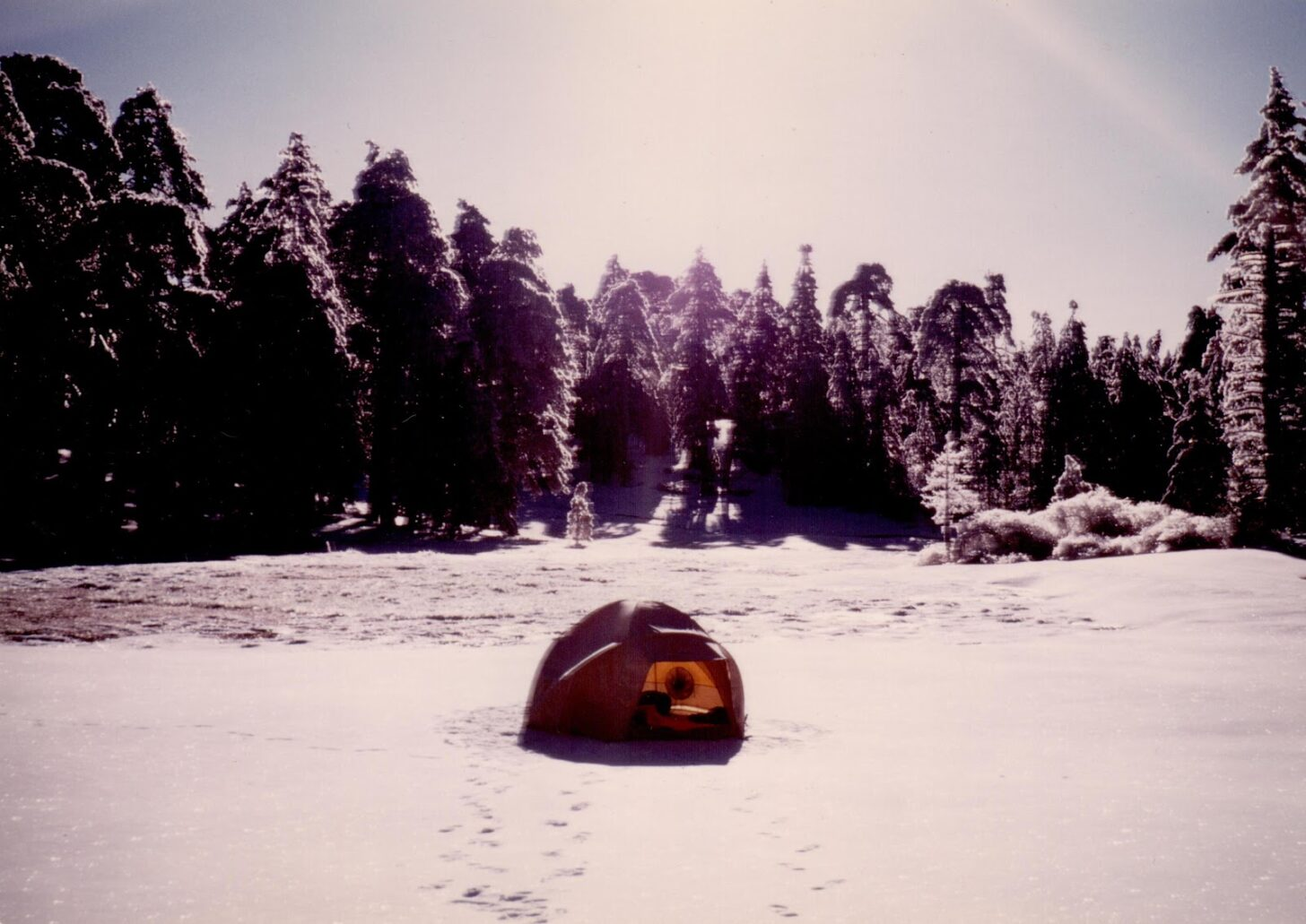 an old geodesic dome tent on a snow field