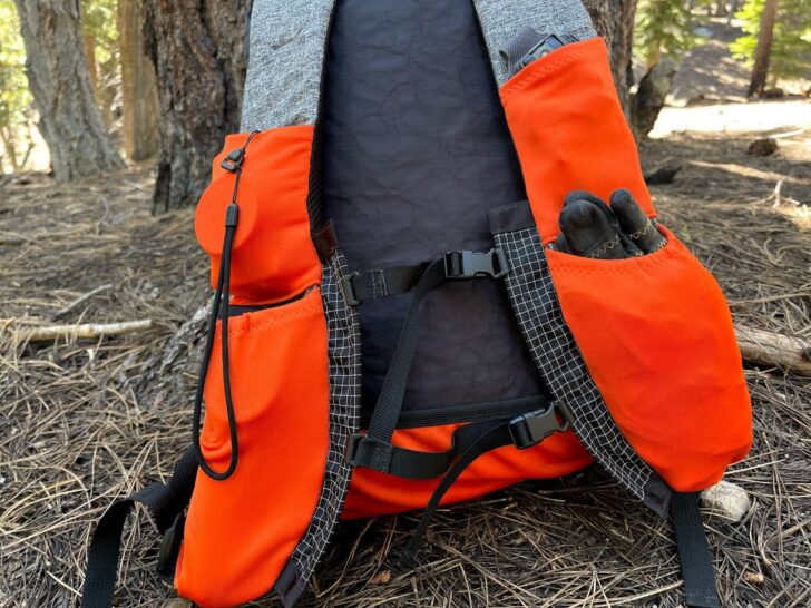 a medium shot showcasing the pockets and vest-style shoulder straps of the pack.