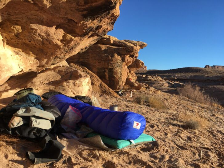 a cowboy-style campsite tucked under an alcove in the desert