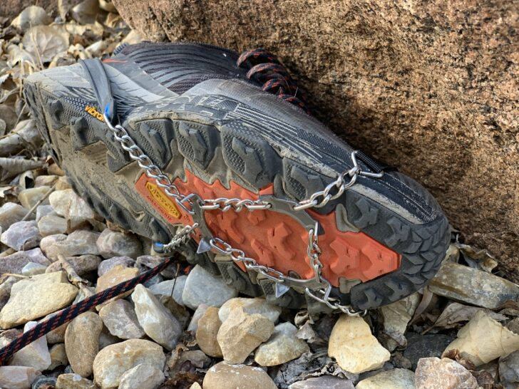 traction spikes on a trail running shoe