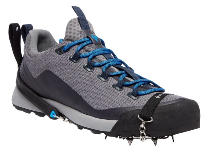 traction spikes affixed to a hiking shoe