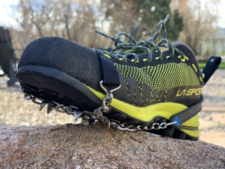 traction spikes on a climbing approach shoe