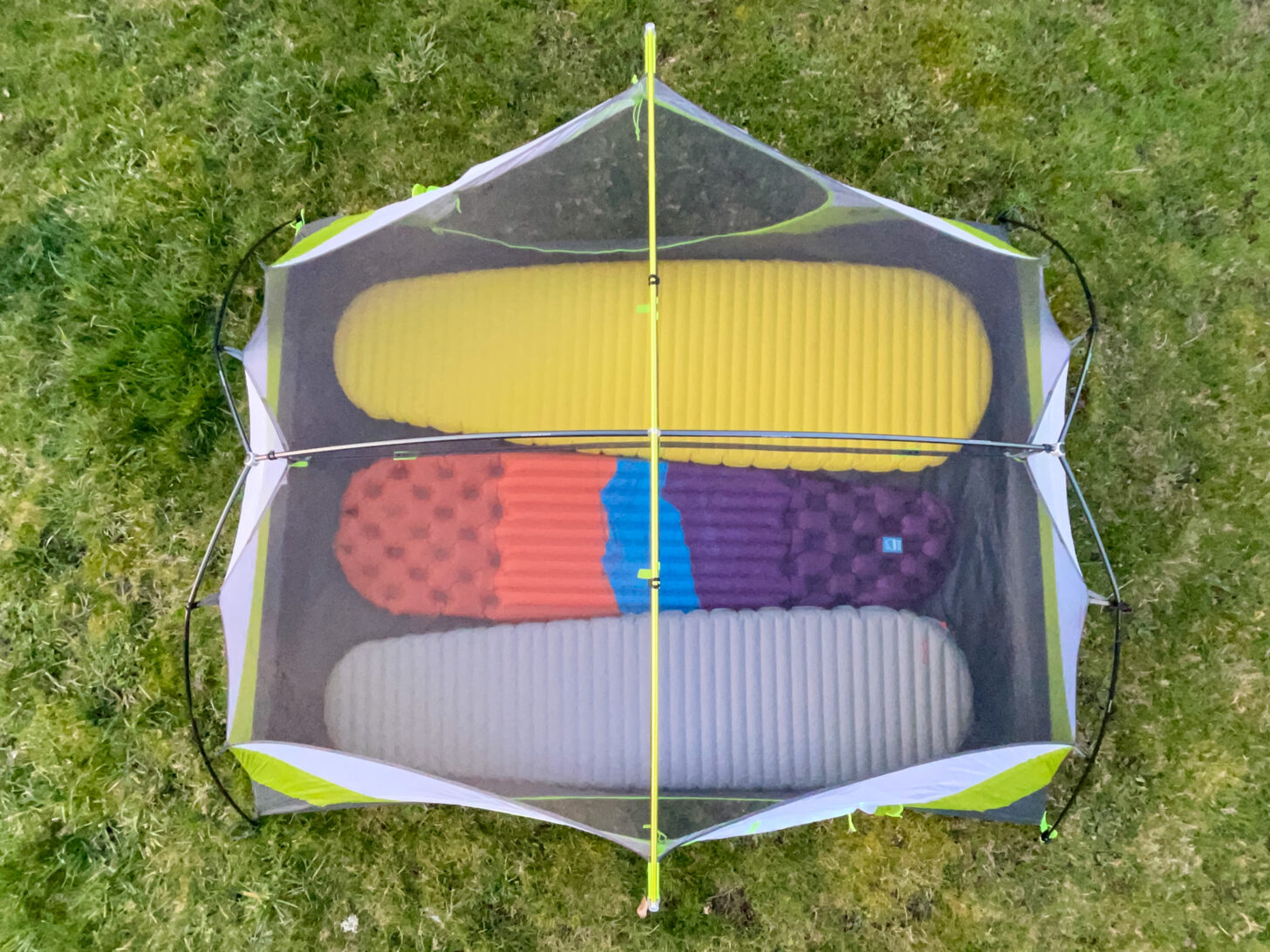 an overhead shot showing how tightly three pads fit inside the shelter.