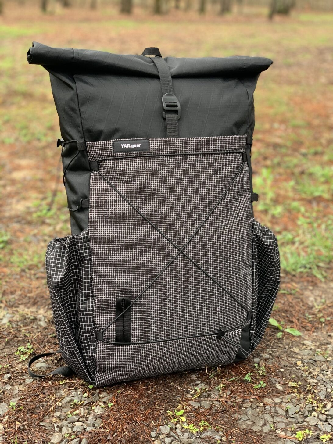 a backpack sits on the ground.