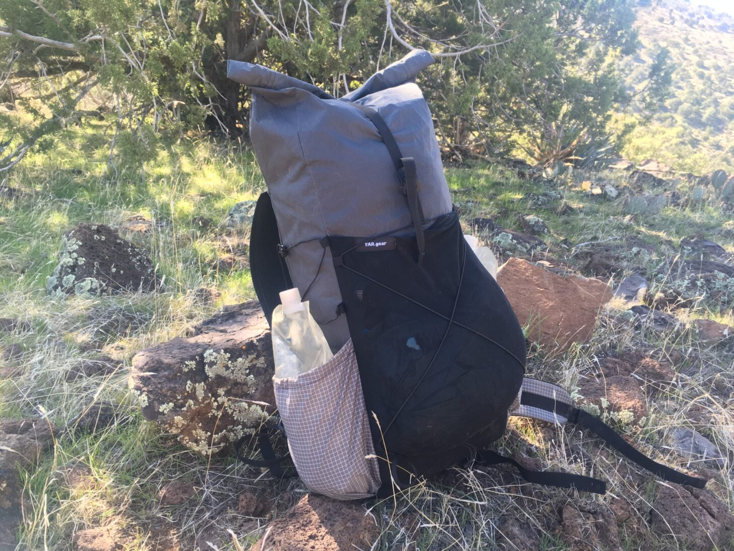 A loaded pack sits on the ground.