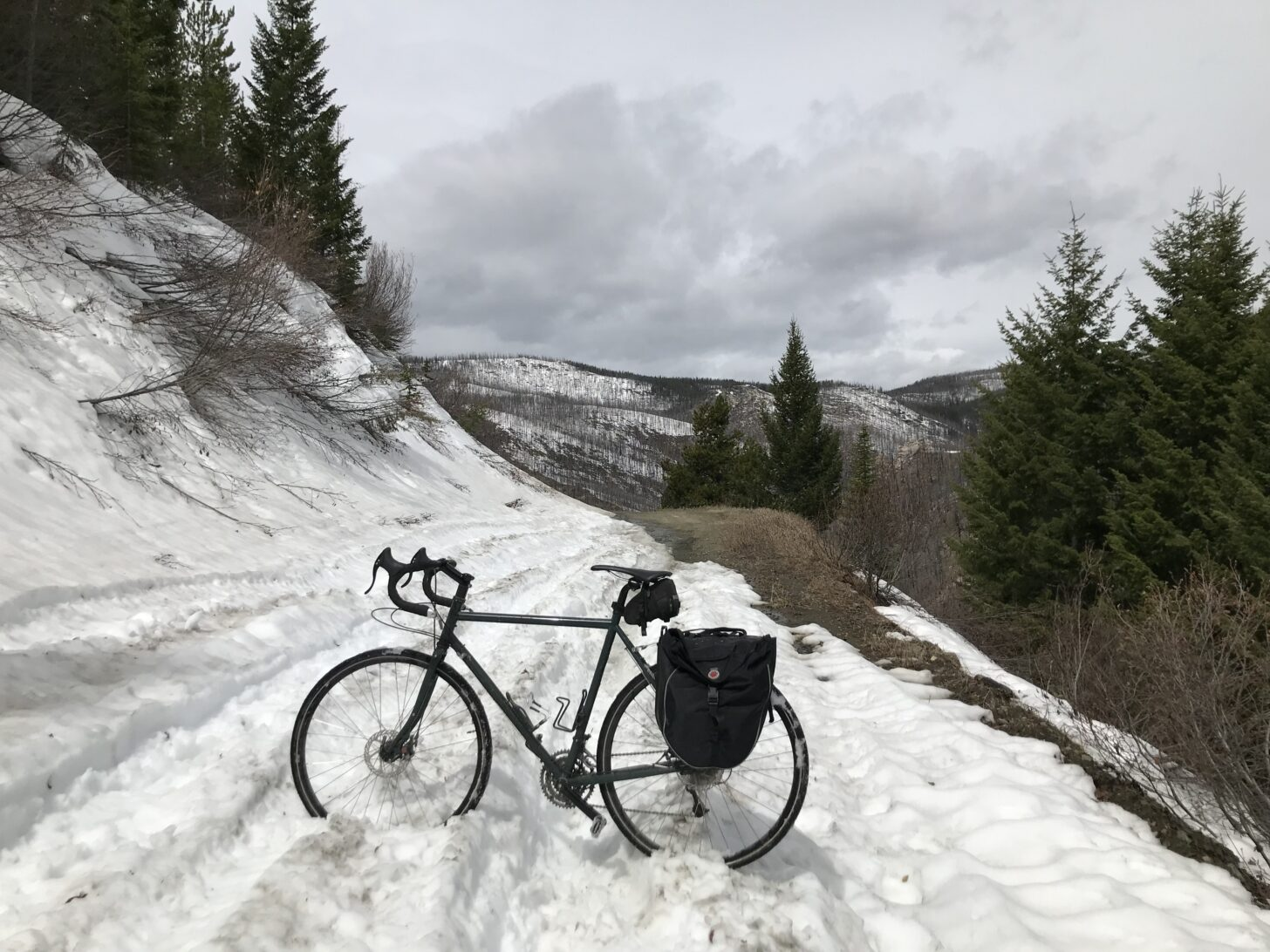 a bicycle standing up in a snow drift