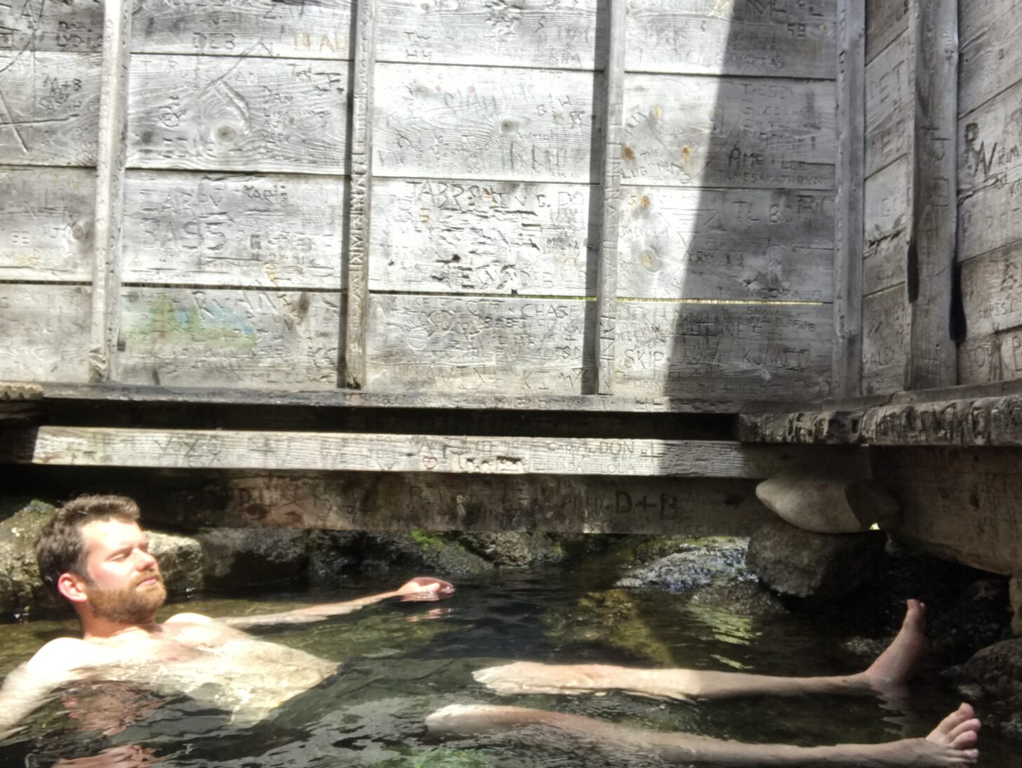 a man floats in a hot springs