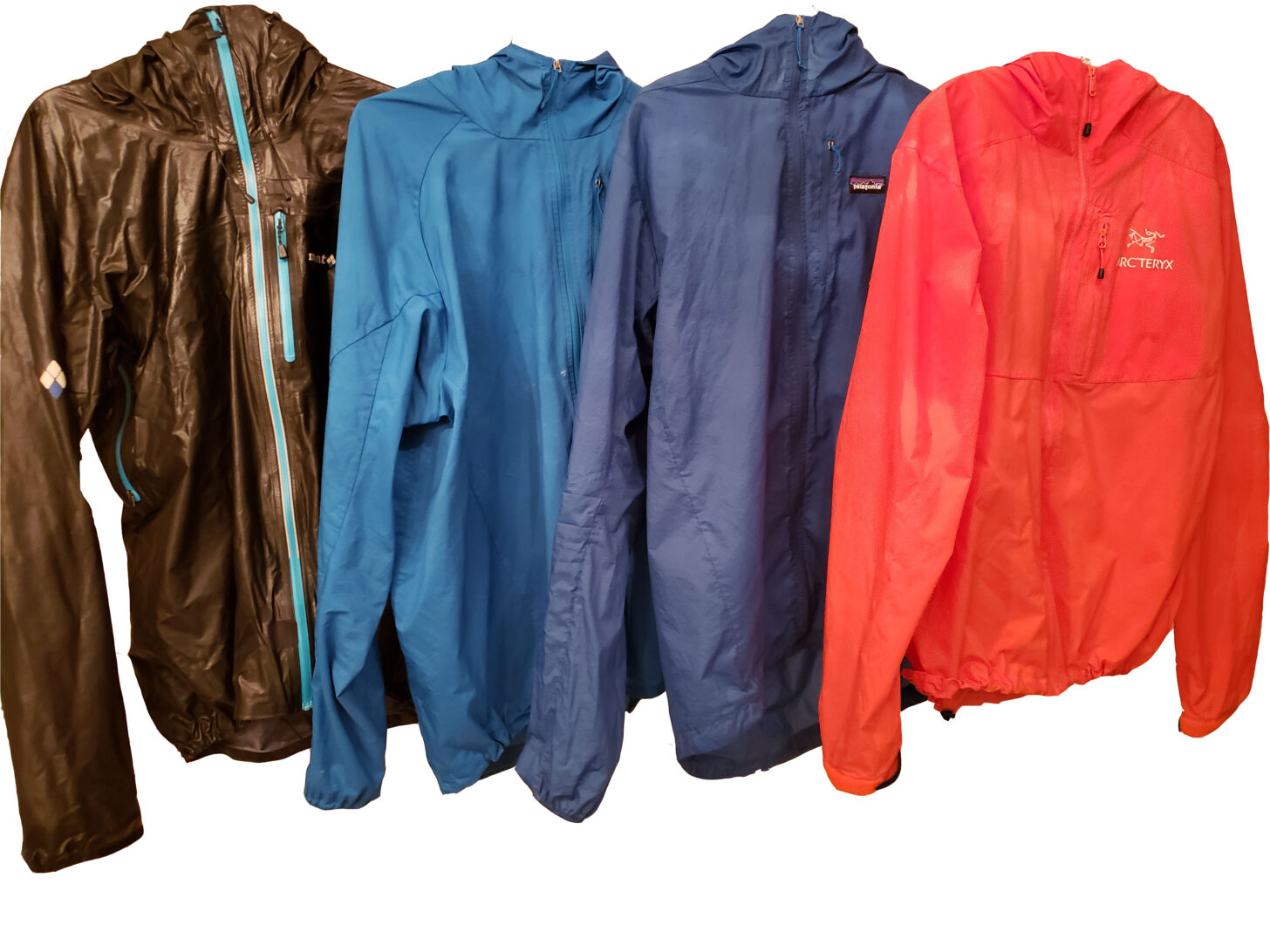 Four outdoor jackets against a white background.