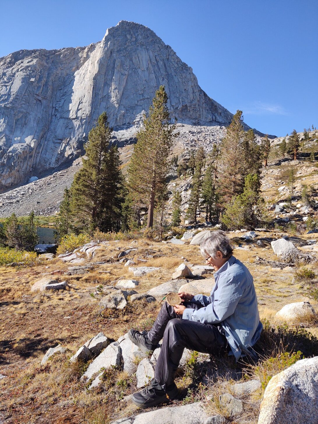 Woman sitting with mountain in background