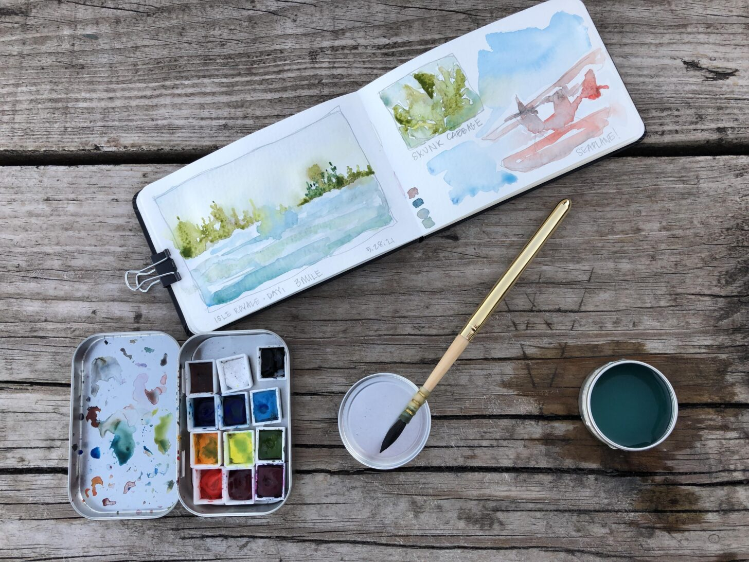 Watercolor paints with notebook