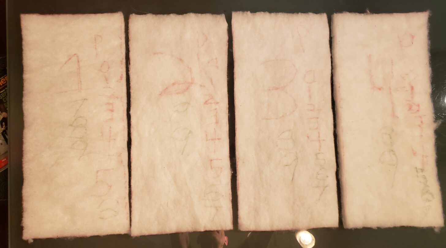 four samples of insulation aligned side by side against a neutral background. The samples are off-white and shaped like bricks.