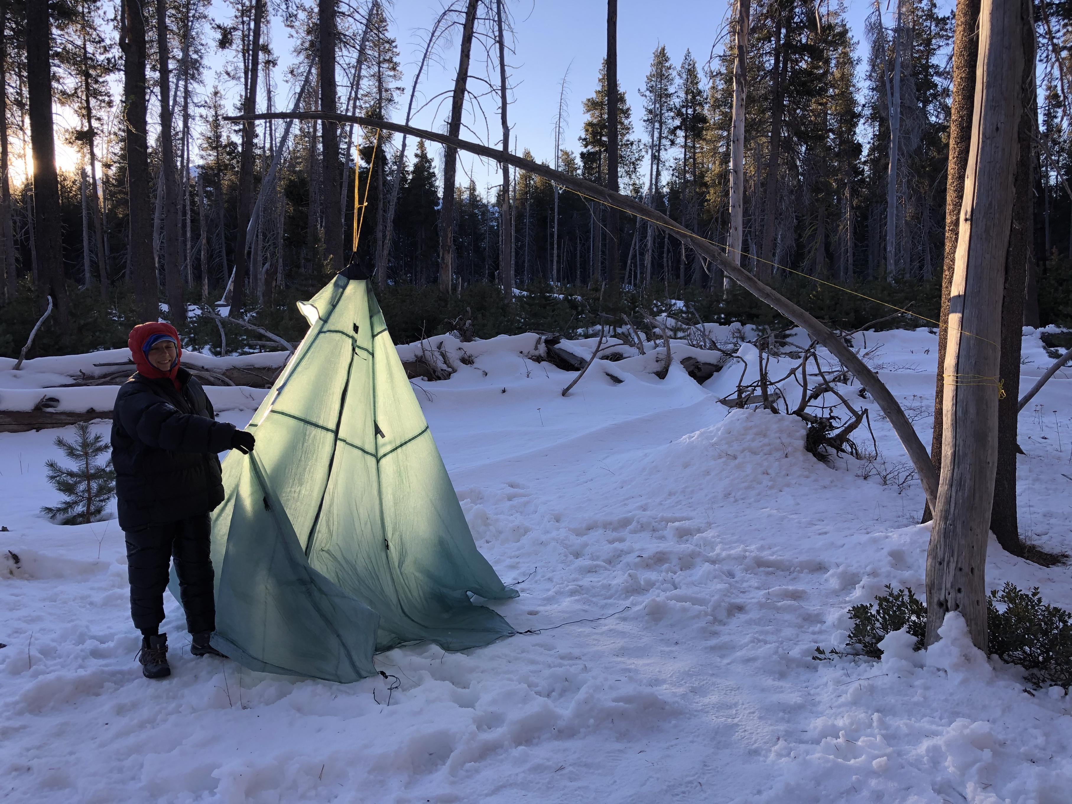 Gela takes down the tent